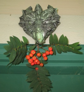 "photo of Dragon ""Green Man"" with Rowan Berries"