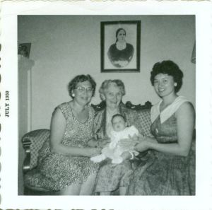 Miriah as a baby, with Mom Judith, Grandma Lucille, Great-Grandma Julia, and (in the portrait) Great-Great-Grandma Maria