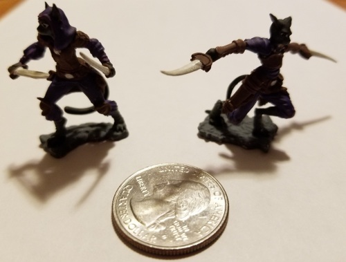 photo of tabaxi DnD miniatures with quarter to show size
